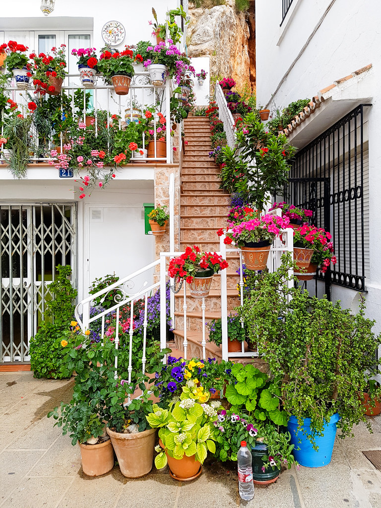 a house decorated with flowers in Mijas Pueblo