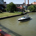 small boat going under Center Street Bridge