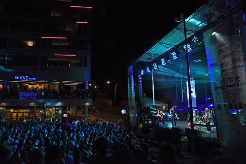Spin Doctors perform on the Belltower stage in front of the aloft hotel.