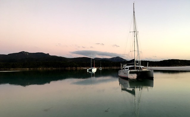 Morning high tide at Hill Inlet. The catamarans 'Jigsaw' and 'Slim'.