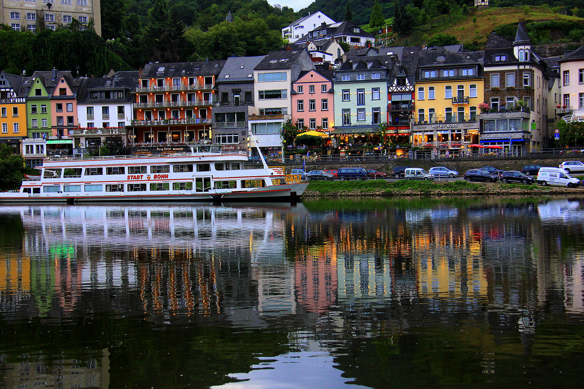 Reflections of Cochem on Moselle river