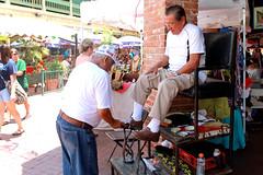 My dad getting a shoe shine.
