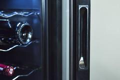 handle ans glass door of a wine cooler / fridge