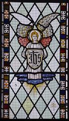 Angel holding the IHS monogram