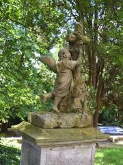 angel garlanding a cross
