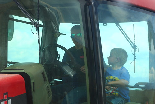 Chase riding with his mama, Casey, in the grain cart.