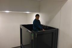 Wheelchair lift in post office bathroom