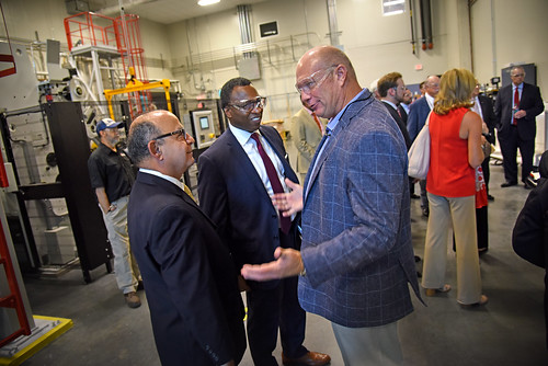Nonwovens Institute executive director Dr. Behnam Pourdeyhimi (left) chats with UNC system's Kevin Howell and Board of Governors' member Harry Smith, Jr. (right) during a tour of Centennial Campus.