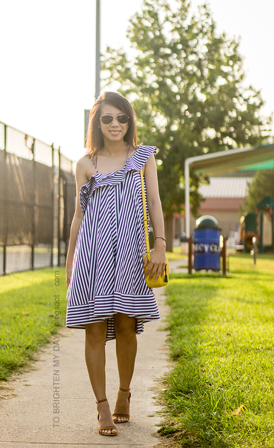 blue striped ruffle dress, yellow camera bag, brown suede sandals