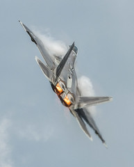 Lockheed Martin F-22A Raptor Maneuvers with Afterburners and Creates a Condensation Cloud