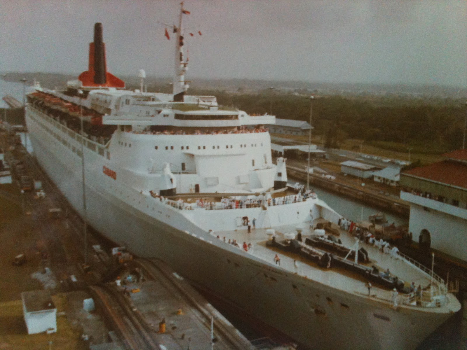 QE2 transits the Panama Canal wearing her short-lived pebble-gray livery, January 1983.