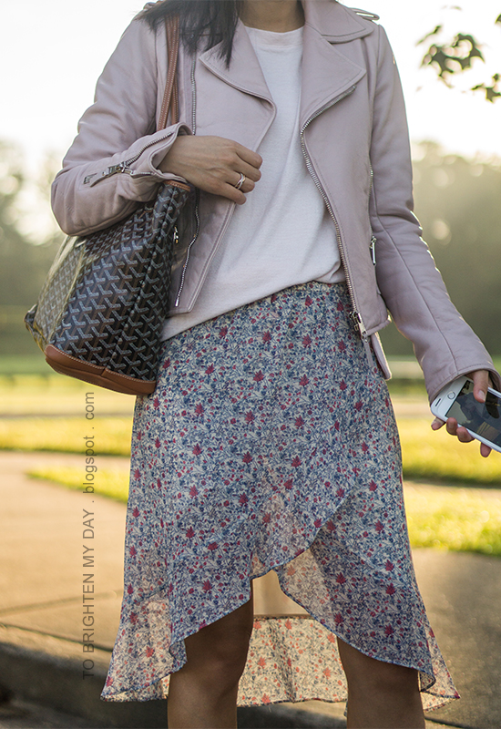 lilac leather jacket, light pink sweater, patterned tote, floral wrap midi skirt