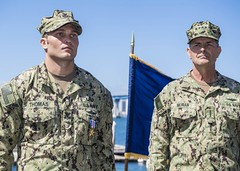 Explosive Ordnance Disposal Technician 1st Class Jeffrey Thomas stands at attention alongside Adm. Bill Moran after being awarded the Silver Star Medal. (U.S. Navy/MC3 Christopher A. Veloicaza)