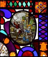 Joseph and Jesus chop wood while Mary sews