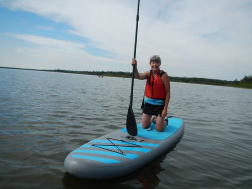 Elk Island Linda on Paddle board kneeling