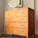 A light oak chest of drawers