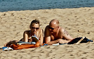 Couple reading at the beach