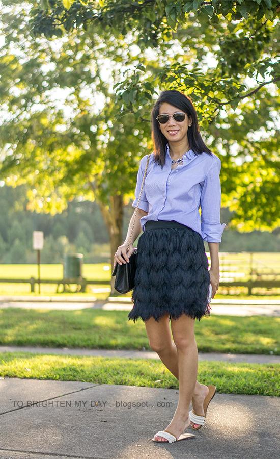 blue striped top with scallops, black fringe skirt, black shoulder bag, fringe flats with embellishments