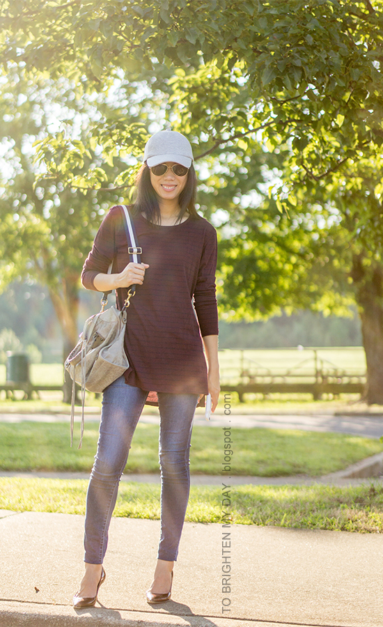 gray baseball cap, burgundy and navy striped tunic top, gray tote with navy striped strap, skinny jeans, burgundy pumps