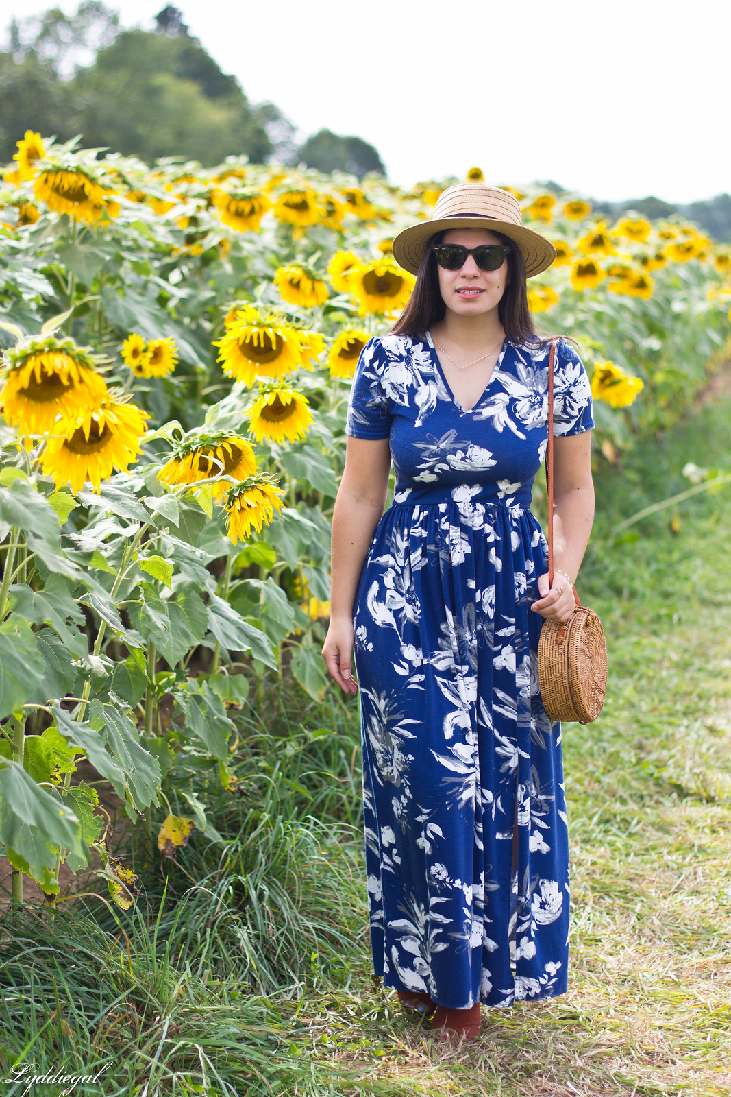 blue floral maxi dress, round rattan bag, straw hat, sunflower field-5