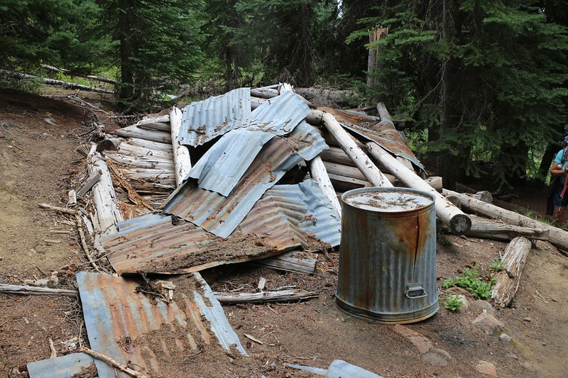 An old collapsed log cabin at the Glacier Peak Mine on the Miners Ridge Trail