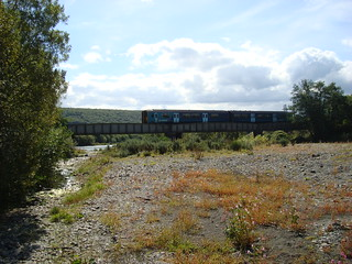 Arriva Trains Wales class 150 DMU crossing a bridge on the Heart Of Wales Line just south of Llandovery