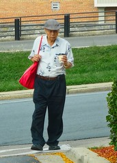 Carrying a bag and cup