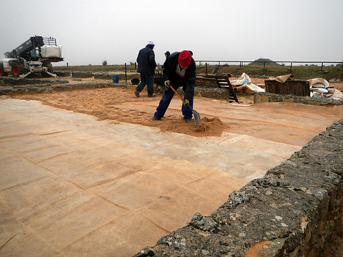 Winterizing the mosaic tiles in Clunia, a Roman ruin that had existed as a town for several hundred years (from pre-Roman times until about the 3rd century AD)