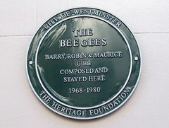 Photo of The Bee Gees, Barry Gibb, Robin Gibb, and Maurice Gibb green plaque