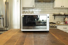 compact Frigidaire wine refrigerator on countertop in kitchen
