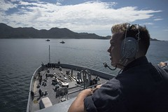 Operations Specialist 3rd Class Andrew Pilieri stands watch on the bridge wing as USS San Diego (LPD 22) arrives in Vietnam, Aug. 6. (U.S. Navy/MC3 Justin A. Schoenberger)