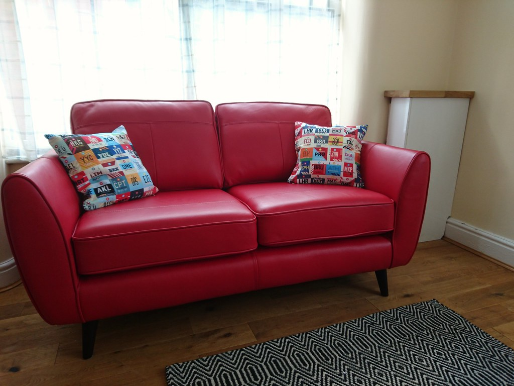 My new sofa, complete with my fantastic Airport Tag cushions.