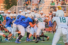 JV O Line Pushing Defense off the Line of Scrimmage
