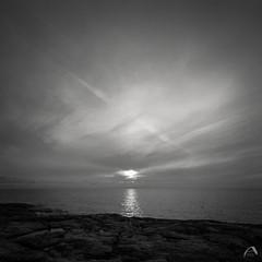 Sun setting in the sea