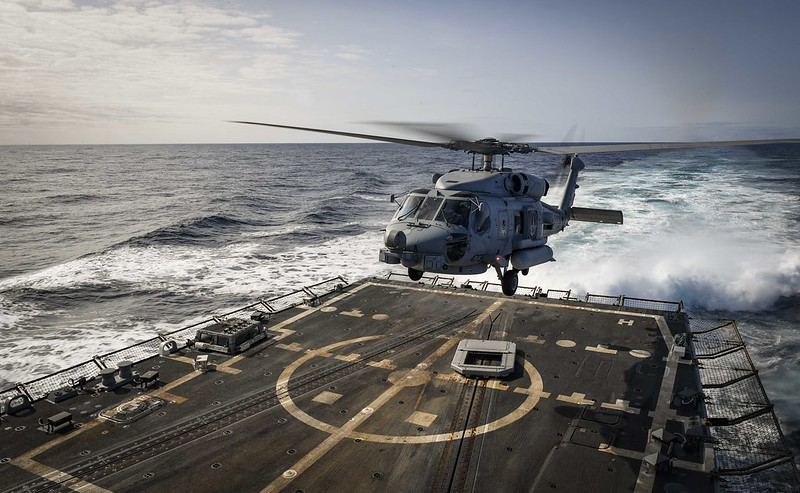 An MH-60R Sea Hawk helicopter takes off from the flight deck of USS Oscar Austin.