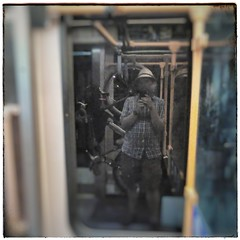 The late night riding home on the MAX Orange Line #selfportrait with bike hanging on hook. #maxlightrail #trimet #orangeline #bikesontrains #bikesontransit