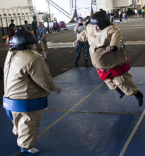 Sun, 08/20/2017 - 22:01 - 170820-N-RZ514-057 ATLANTIC OCEAN (Aug. 20, 2017) Sailors and their guests participate in a 'sumo fight' during a Tiger Cruise aboard the aircraft carrier USS George H.W. Bush (CVN 77). The ship and its carrier strike group are transiting home from a scheduled seven-month deployment in support of maritime security operations and theater security cooperation efforts in the U.S. 5th and 6th Fleet areas of responsibility.  (U.S. Navy photo by Mass Communication Specialist Seaman Jennifer M. Kirkman/Released)