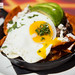 Lamb Barbacoa Chilaquiles - enchilada sauce, avocado, cilantro, queso fresco, crema, fried egg