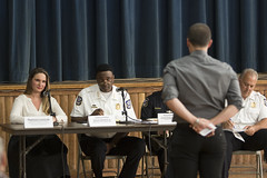 During a forum at Chase Elementary School to discuss police response times, Rep. Stephanie E. Cummings, R-74th District, Waterbury Police Chief Vernon L. Riddick Jr. and Assistant Deputy Chief Edward Appicella (blocked from view) and Deputy Chief Fred Spagnolo listen intently as residents offer their feedback, suggestions and complaints.