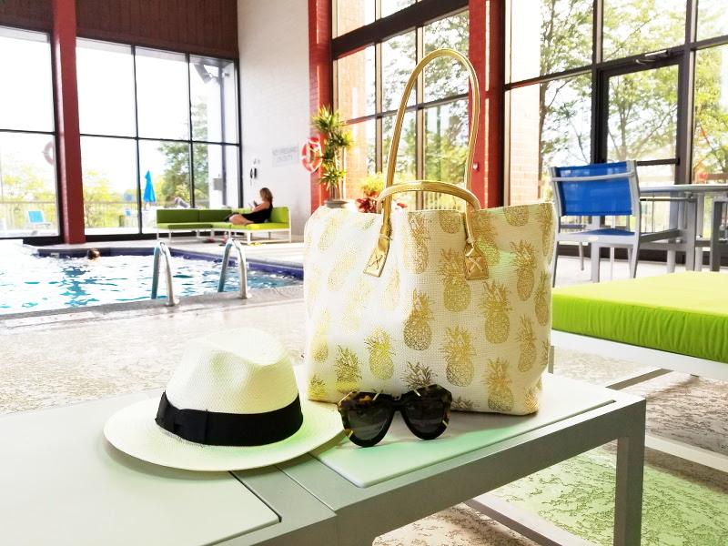 doubletree-hilton-pool-hat-bag-sunglasses-8