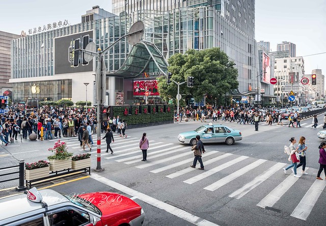 Bustle of people at intersection of Henan Middle Road and Nanjing Road Pedestrian Street, Shanghai, China