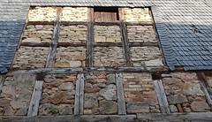 Wall of a barn in Bürden. - Half-timbered. Stones, bricks. Slate-shingled.