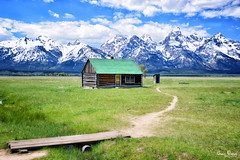 A wooden cabin on the mountain lap