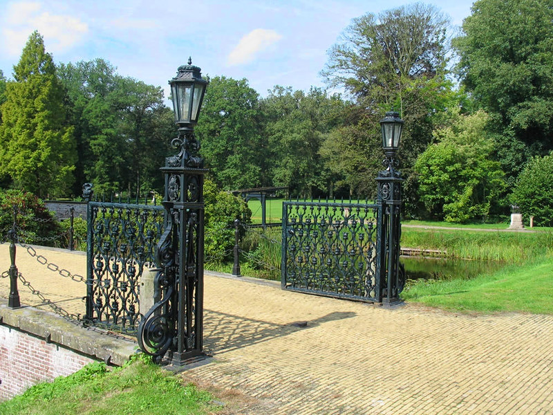 Ornamental ironwork gates to bridge over the moat around Doorn House. Credit Basvb