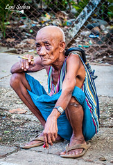 Burmese man waiting for his train