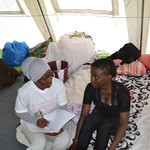 individual counselling a teenager in the tent