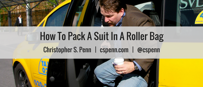 How to pack a suit in a roller bag.png