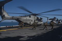 Marines disembark a CH-53E Super Stallion on the flight deck of USS Bonhomme Richard (LHD 6) as part of a certification exercise, Aug. 18. (U.S. Navy/MC2 Cameron McCulloch)