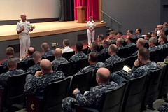 Adm. Scott Swift, accompanied by Pacific Fleet Master Chief Suz Whitman, speaks with commanding officers, executive officers and command master chiefs in Yokosuka, Japan, Aug. 24. (U.S. Navy photo)