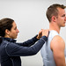 Exercise physiologist, Kayla Hierholzer, installs a wireless transmitter into base-layer shirt with an embedded sensor worn by O-2 Wes Baker at the 711th Human Performance Wing, Air Force Research Laboratory at Wright Patterson Air Force Base in Dayton, Ohio. The 711th Human Performance Wing runs the (STRONG) program in which researchers in physiology, bio-signatures, physical training, nutrition and supplementation and sensors assess cognitive and physical performance bio-signatures in order to generate ways to develop training, supplementation and technology for performance enhancement. (U.S. Air Force photo by J.M. Eddins Jr.)